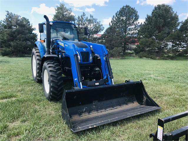 New Holland TS 140 Dual Power tractor/loader  AuctionTime