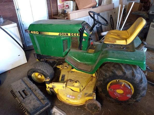 John Deere lawn mower and tiller