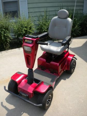 4 Wheel Wrangler Pride Mobility Scooter (like New- Price Red