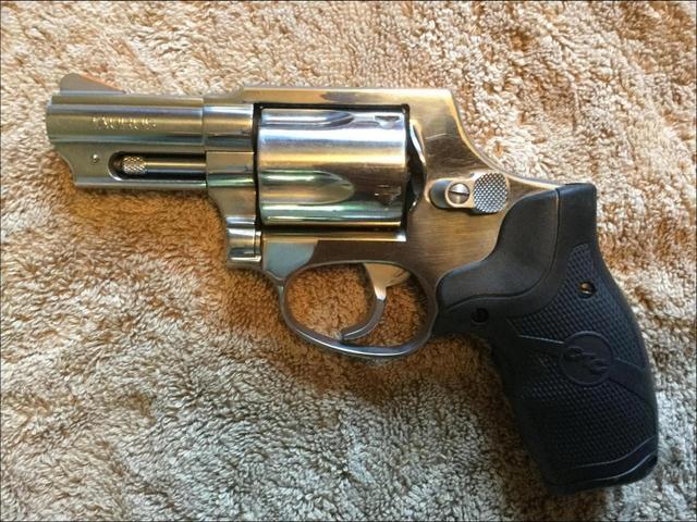 Taurus 605 revolver w/ Crimson trace laser